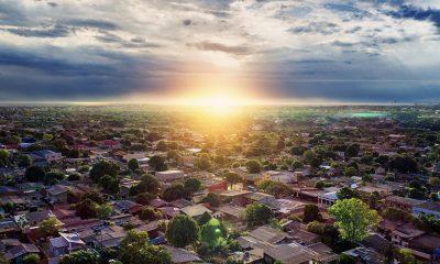 Sunrise over affordable housing REIT neighborhood