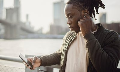 Man looking at phone, showing advancement of AI technology while searching for housing.