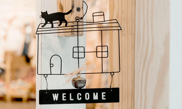 A welcome sign inside of a home that cannot be removed thanks to updated code of ethics