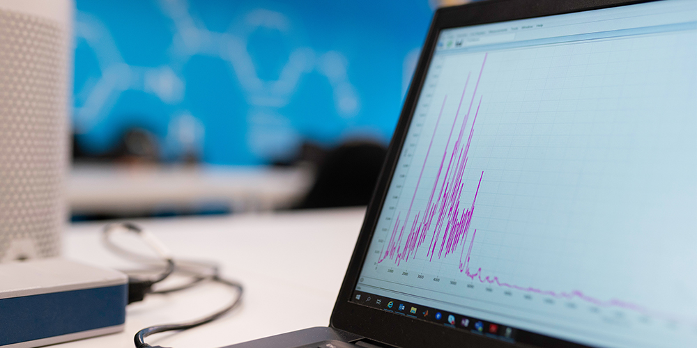Web analytics open on a desktop screen on a table.
