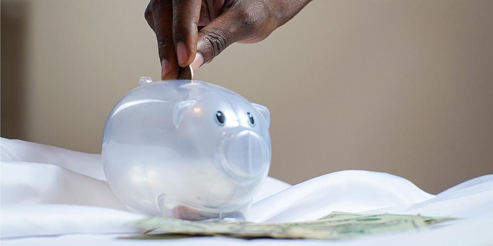 Plastic clear piggy bank representing savings.