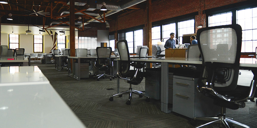 Empty startup office with open floor plan, abandoned while working from home.
