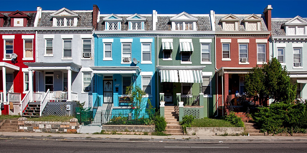 A neighborhood with close-together houses, with different livability factors.