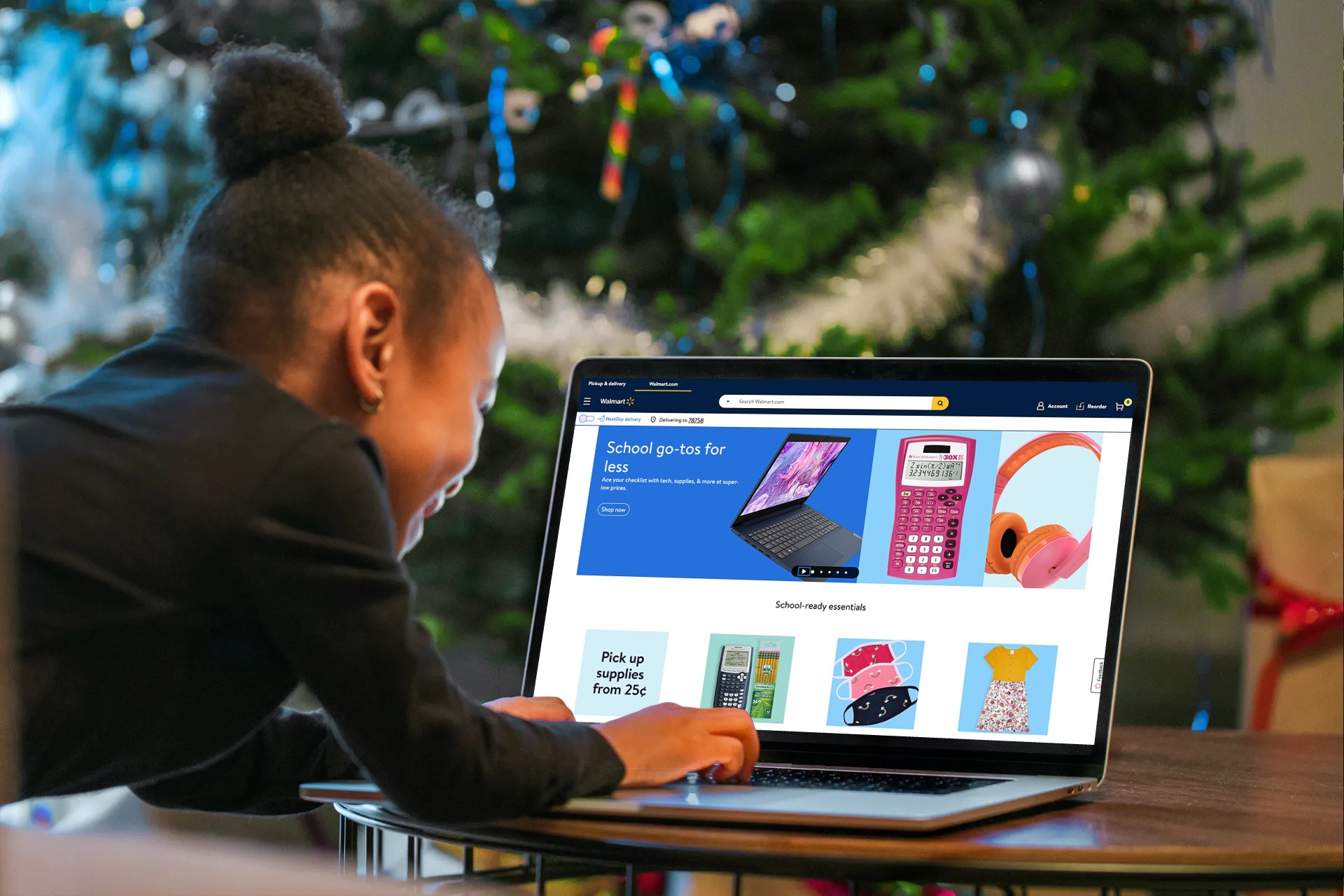 girl looking at walmart home screen on laptop