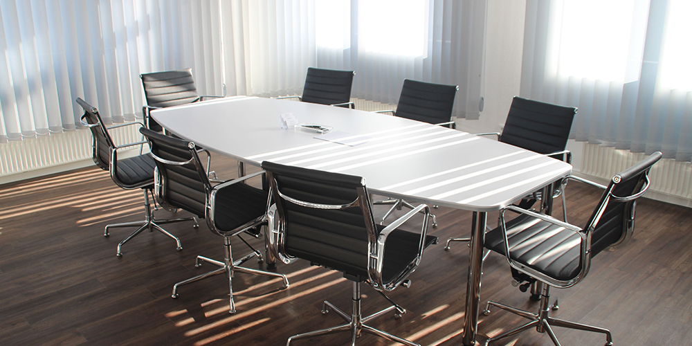 An empty meeting room, unfilled by work from home employees.