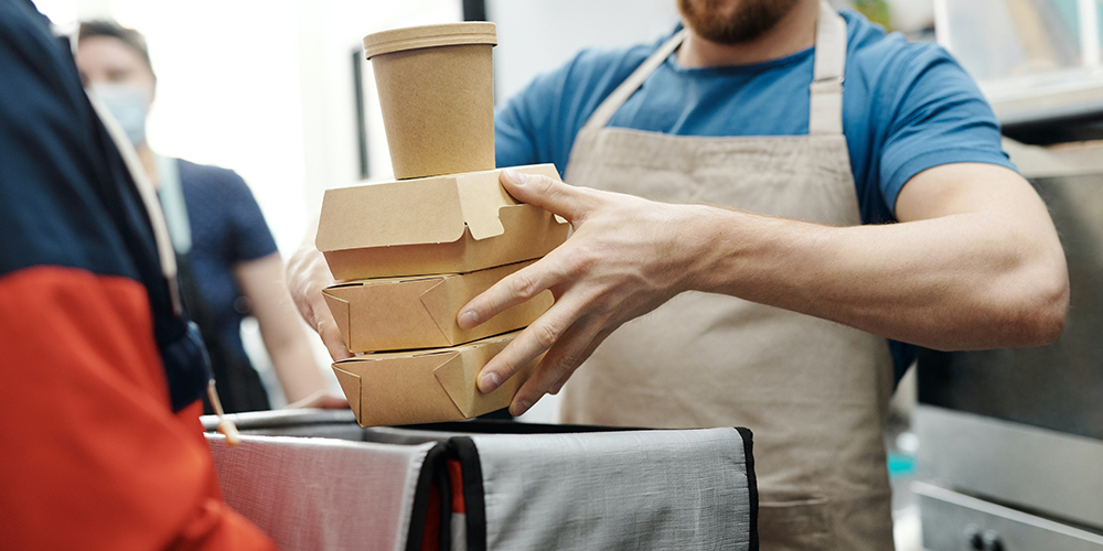 Restaurants prepares delivery or to-go food for safety