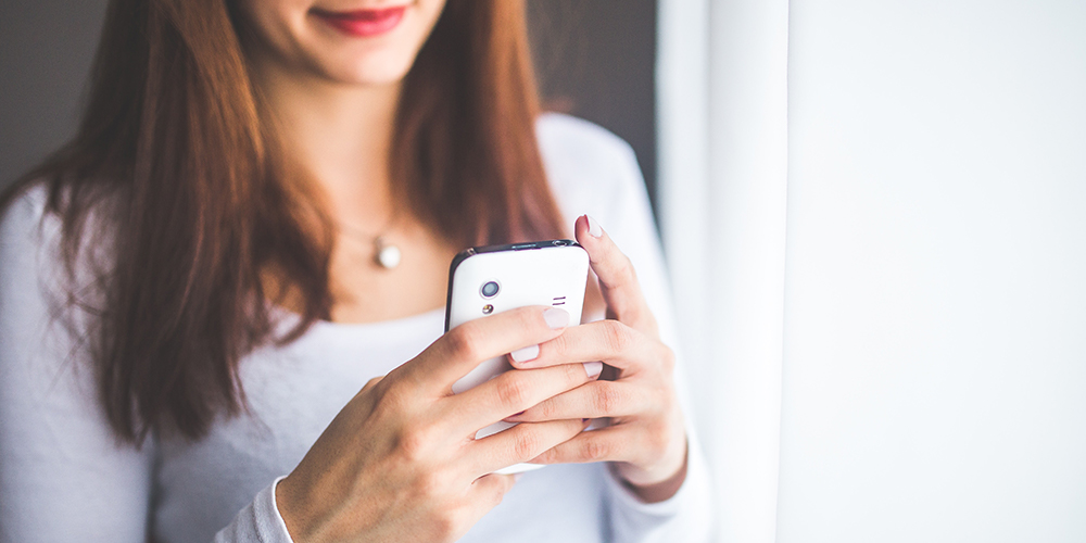 Woman checking Instagram on phone