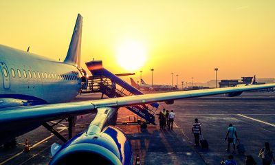 Airlines boarding passengers at sun rise.
