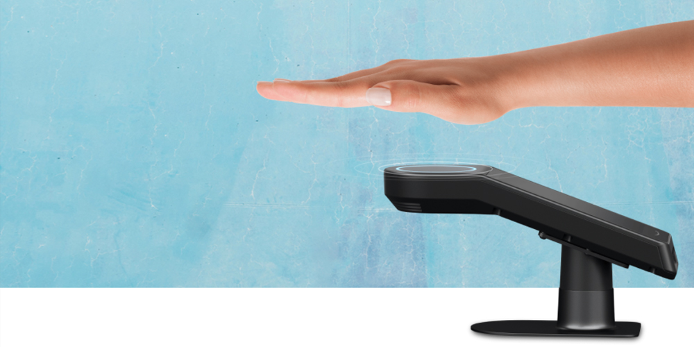 Amazon One ID palm scanner with blue and white background, hand held over it.