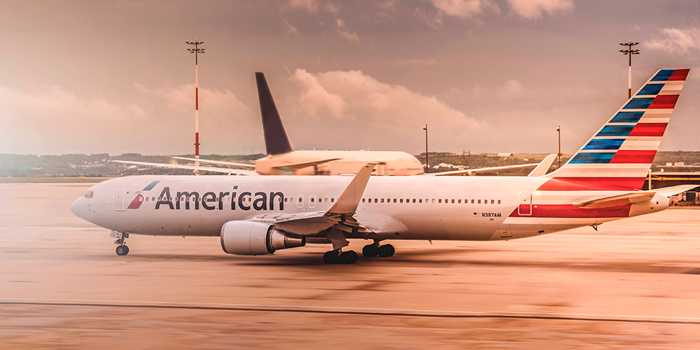 American Airline plane grounded at sunset.