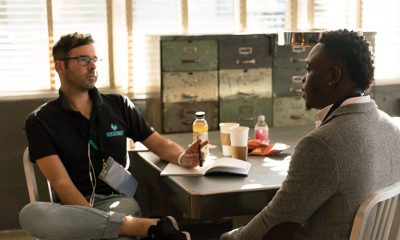 Two men interviewing at a table, job searching.