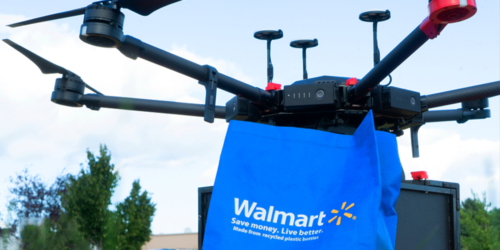 Walmart drones carrying a blue Walmart bag, being tested for grocery delivery.