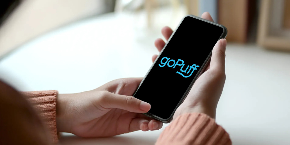 goPuff app open on iPhone in woman's hands.