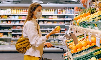 woman shopping at grocery store with mask on