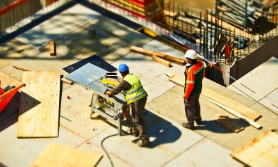 Construction workers performing jobs at site.