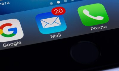 Email icon with 20 possible spam emails on phone screen.