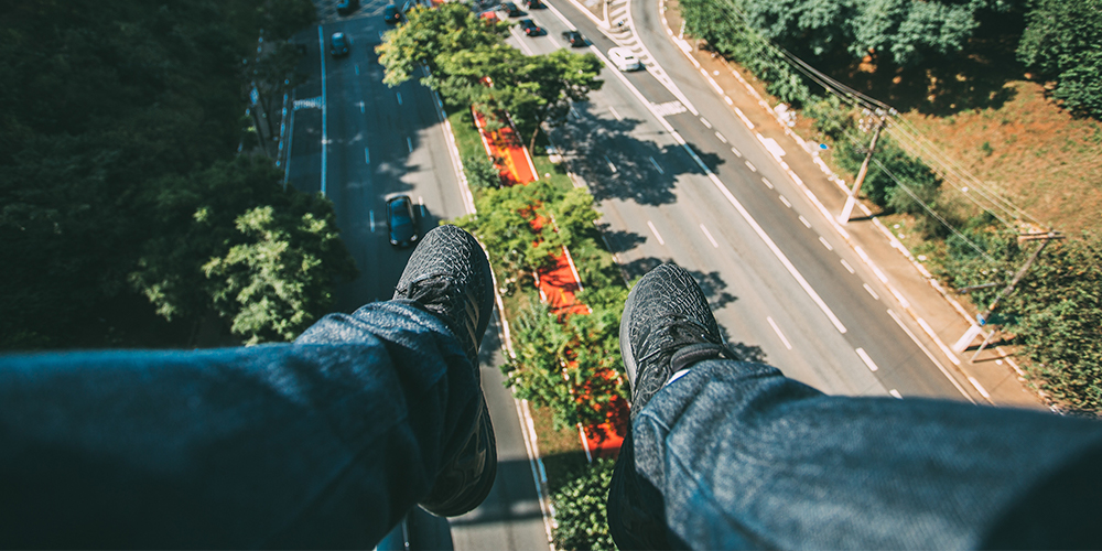Feet dangling above air, showing a possible future with flying cars
