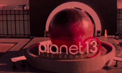 Exterior of Planet 13 building with red filter.
