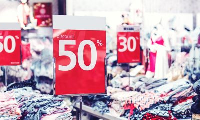 Discount signs over retail sales and clothing