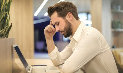 Stressed man thinking over laptop about unemployment.