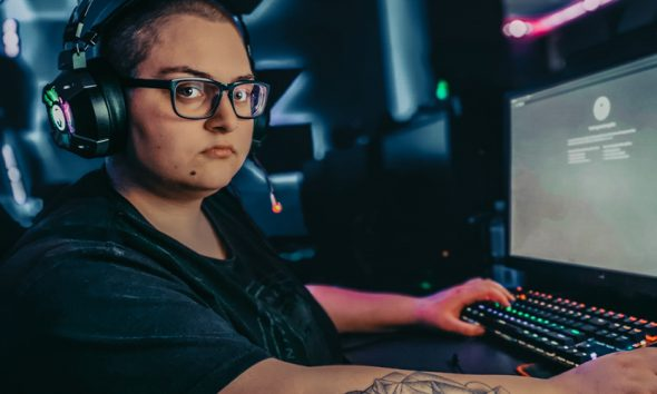Twitch streamer in front of gaming PC, likely to face DMCA claims.