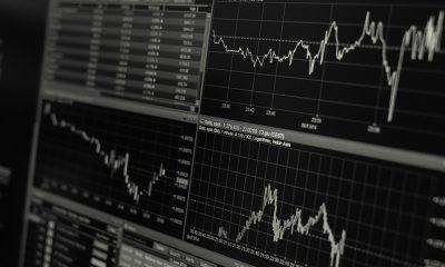 Black and white data screens monitoring productivity.