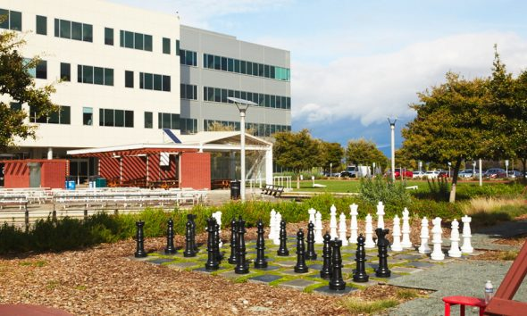 Google complex with human sized chessboard, where a labor union has been formed.