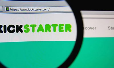 Magnifying glass over Kickstarter URL and site, a crowdfunding website.