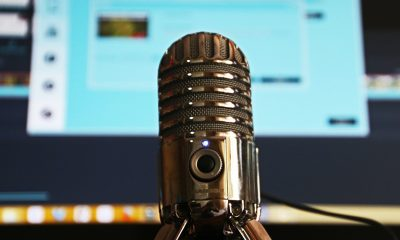 Podcasting mic in front of a computer recording a podcast