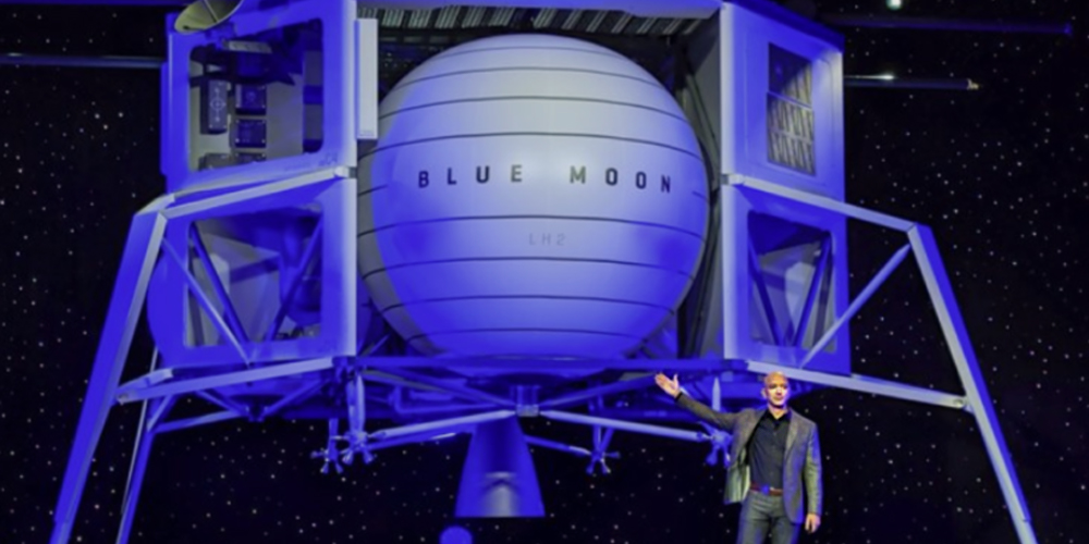 Jeff Bezos standing in front of very large Blue Moon spacecraft.