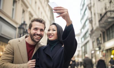 Couple taking video with mobile phone, prepared for e-commerce.