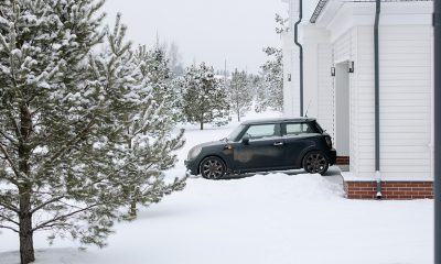 Snow storm disaster, inches of snow where it was unexpected in front of a home and car.