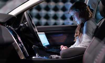 Woman in car working on engineering now allowed a flexible schedule for working from home.
