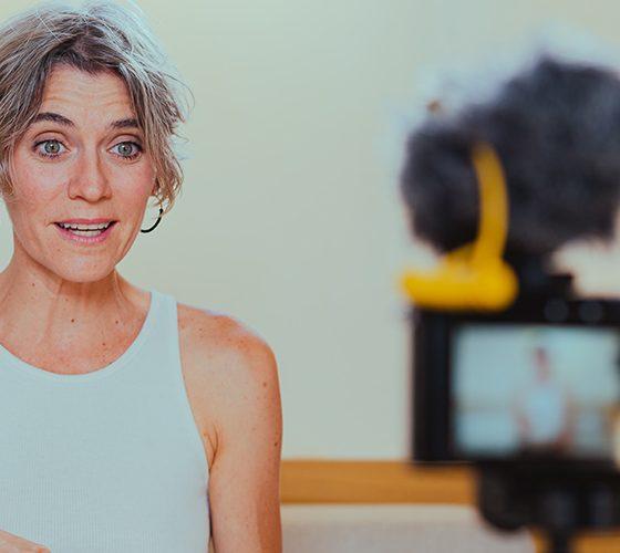 Influencer speaking to camera for marketing segment.