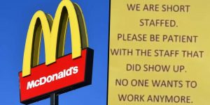 "McDonald's sign with a sign that says ""We are short staffed. Please be patient with the staff that did show up. No one wants to work anymore."""