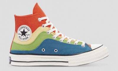 Converse shoe with red, yellow, green, and blue striations in recent conflict over alleged design theft.