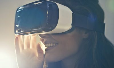 Woman wearing a VR headset in warm sunny lighting, PTSD patients treatment