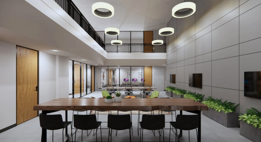 Two story dining or conference area in the workspace.