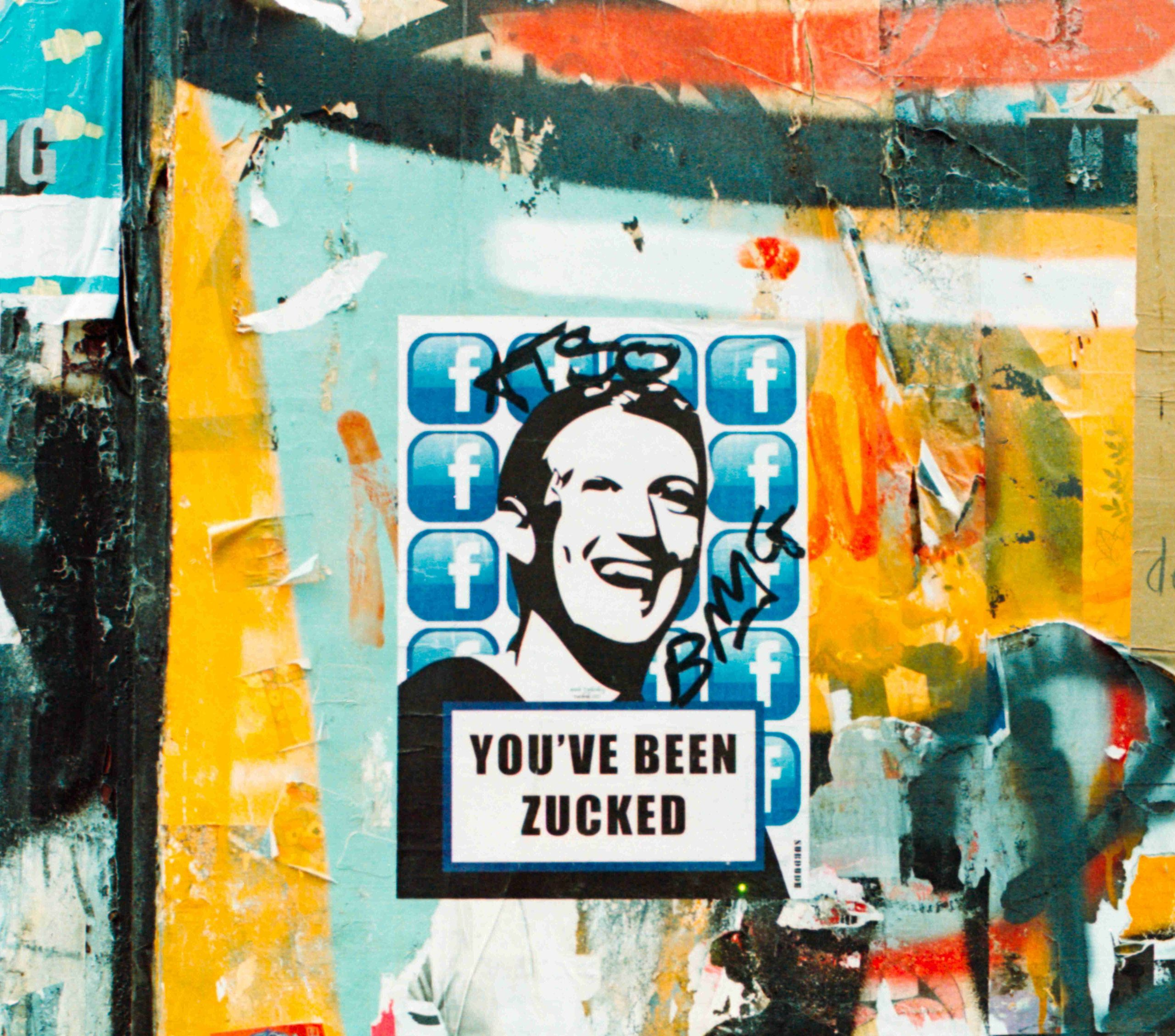 """Graffiti wall with image of Facebook founder, Mark Zuckerberg, with the saying """"You've been Zucked."""""""